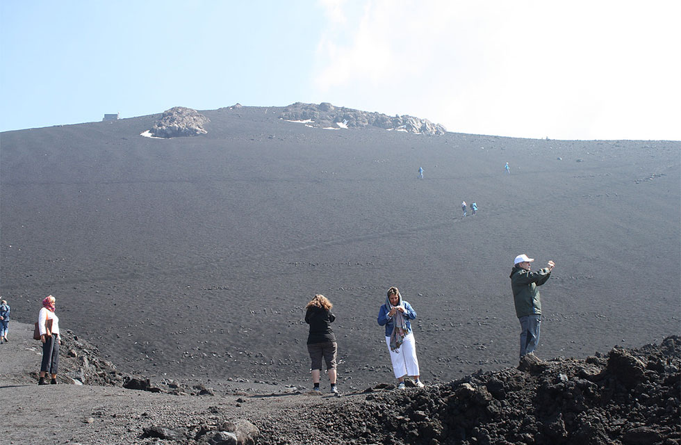 Touring Sicily Holiday and taking photos at Mount Etna, Sicily