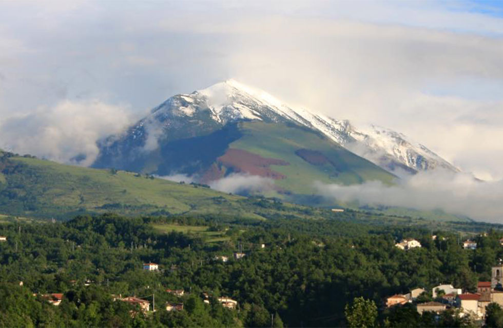 Snow-capped La Majella Mountain in May. The view from Italian Provincial Tours' accommodation on our Abruzzo tours Italy