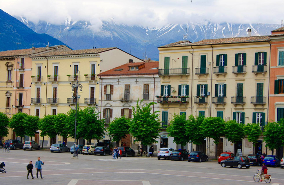 Abruzzo Private Italy Tours of Piazza Garibaldi Sulmona in spring surrounded by snow-capped mountains