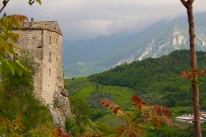 Building on cliffside in Pescosansonesco in the Abruzzo countryside on a cloudy day